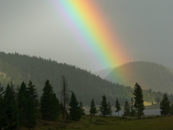 A brilliant rainbow over a Cascade Valley in British Columbia.