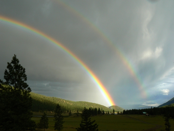 A photograph can hardly captures the magic of the moment as two full rainbows arch over our valley.